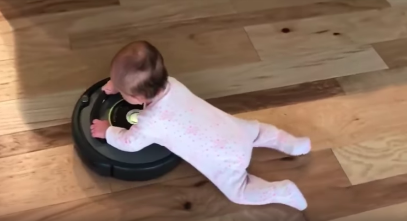 This is what will happen when you give a Roomba vacuum to a baby...