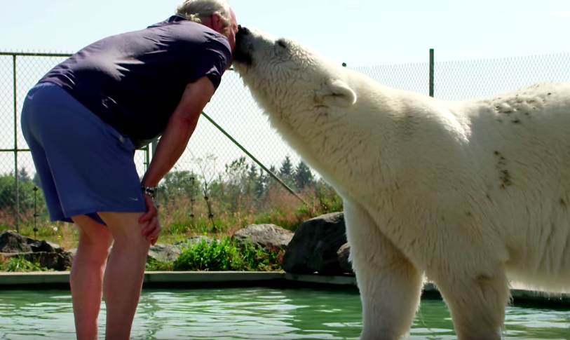 Polar bear bonding with her human father will warm up your heart!